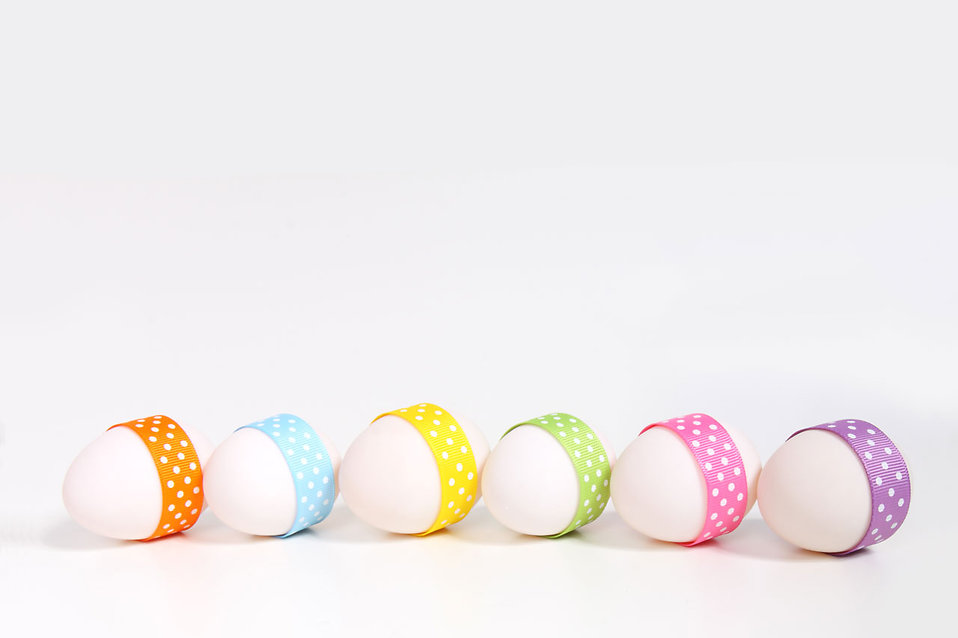 10556-a-line-of-easter-eggs-with-ribbons-isolated-on-a-white-background-pv